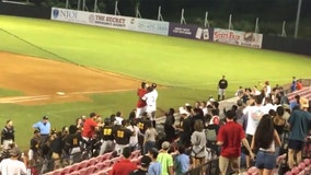 Baseball players confront unruly fans who allegedly poured beer on visiting team