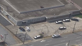 Officers, suspect smash through window during struggle at East Point post office, police say