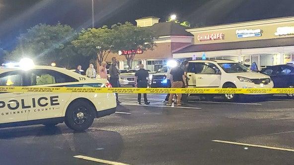 Police investigate deadly shootout at shopping center along Grayson Highway