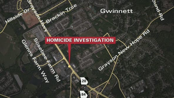 Death investigation at shopping center along Grayson Highway