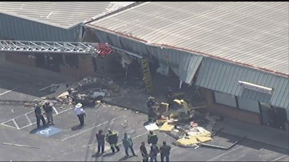 Driver crashes dump truck into Fayetteville antique store