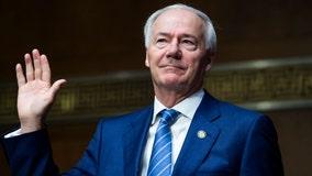 Arkansas governor says he regrets signing mask ban amid COVID-19 surge