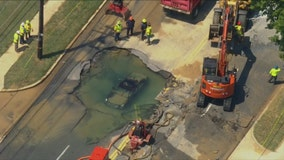 Driver evaded cones surrounding Clinton work area, crashed into sinkhole: officials