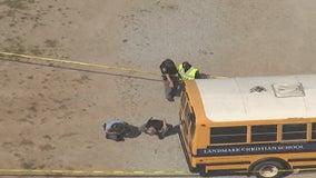 Police: School bus rolls onto driver making repairs in Fairburn, killing her