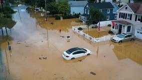 Henri lingers over US Northeast, bringing more rain and flood risk
