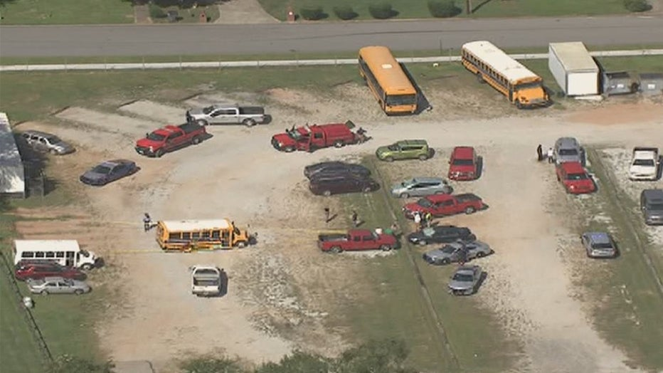 Fairburn police investigate a deadly accident involving a school bus at Landmark Christian School on Aug. 27, 2021.