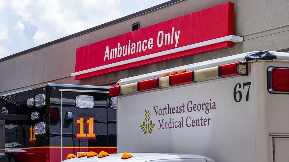 Two ambulances parked outside the ambulance bay at Northeast Georgia Medical Center