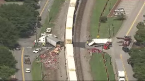 Tractor trailer collides with train, closes roadway in Buford