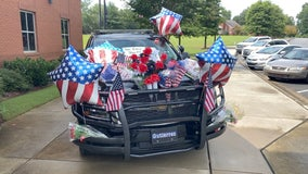 Newnan officer's patrol car now a memorial outside his department
