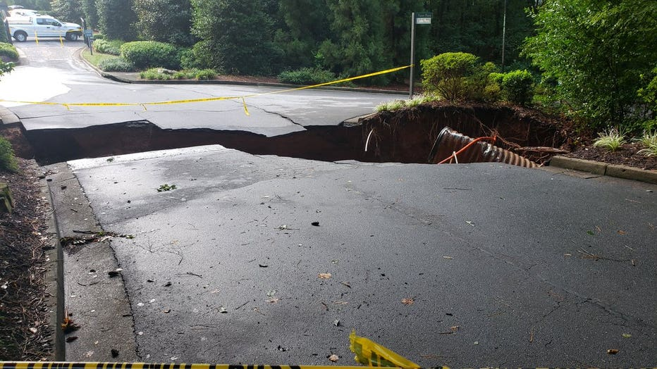 A large sink hole opened along East Lake Parkway in Marietta following a large influx of rain Tuesday night (Credit: James C. Tolliver).