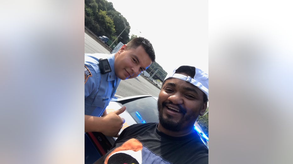 Breon Rahmaan (right) says a Georgia State Patrolman went above and beyond to help him after he became stranded on the roadside (Credit: Breon Rahmaan)
