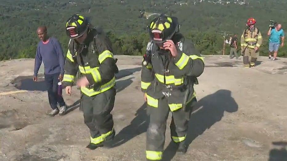 firefighters climb stone mountain