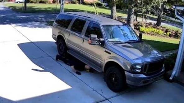 Marietta woman catches man sliding under her SUV