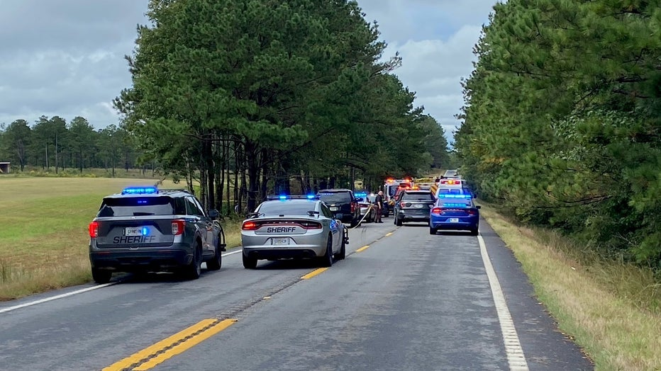 State and local law enforcement investigate a deadly crash along Highway 18 near E. Drummond Road on Oct. 5, 2021.