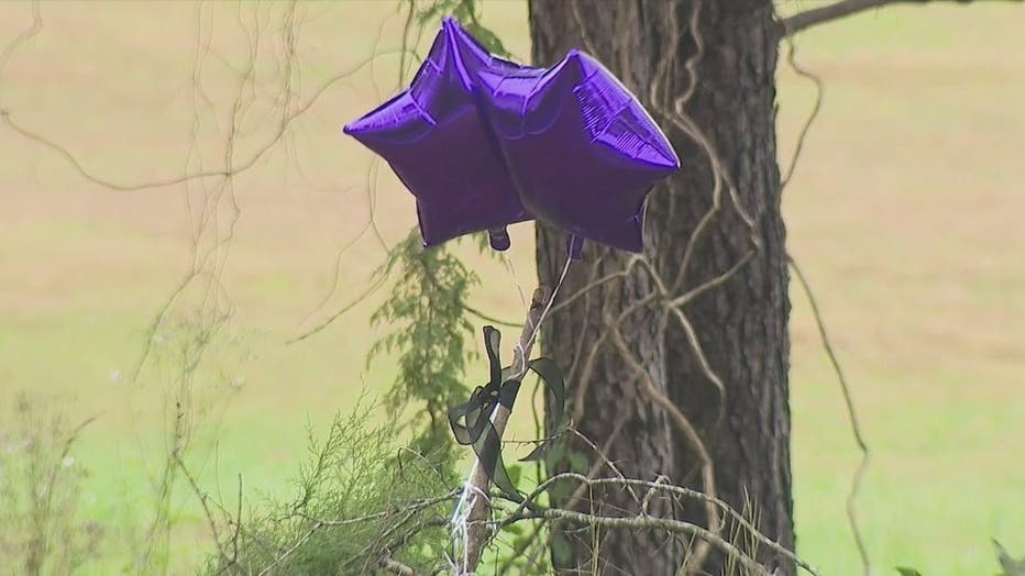 Two balloons mark the tree where Akeila Ware crash after shots were fired at her in Troup County. Ware and her unborn child died from their injuries on Oct. 5, 2021.