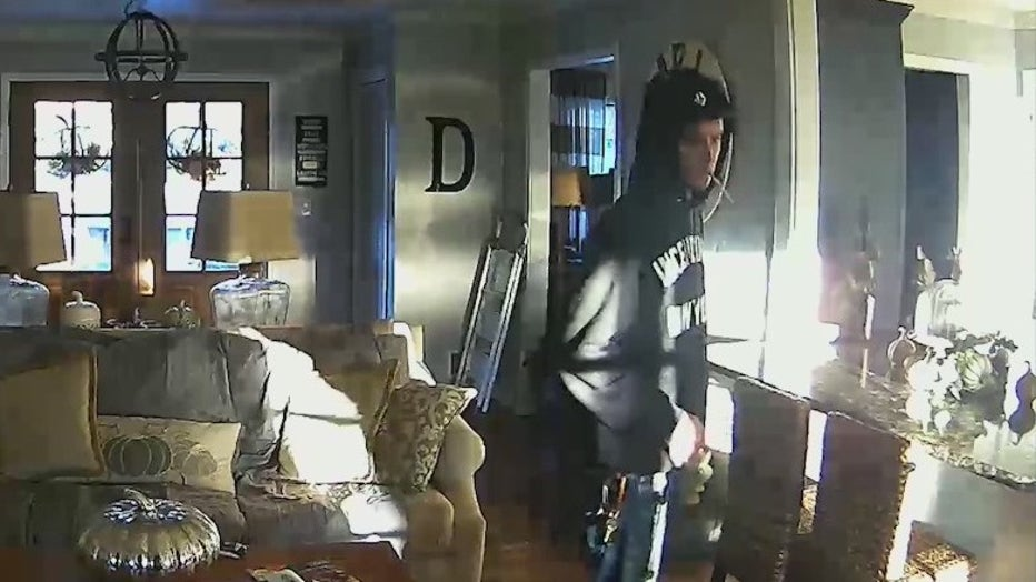 A man is caught by home surveillance walking around a Marietta family's home.