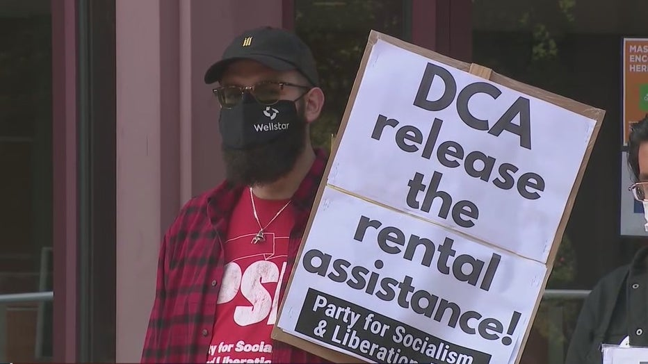 Demonstrators rallied outside the Georgia Department of Community Affairs calling for all federally allotted money towards rental relief to be released on Oct. 1, 2021.