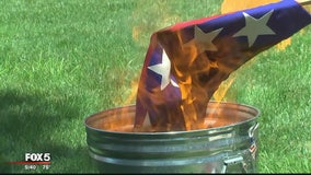 Activist burns Confederate-Nazi flag outside Leesburg courthouse