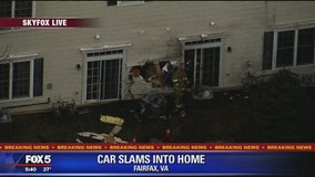Car crashes into home in Lorton