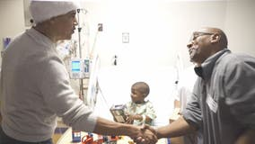 Obama makes surprise visit to hand out gifts to patients at Children's National Medical Center