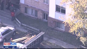 Police searching for driver who crashed into apartments and then fled scene