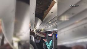United Airlines ceiling panel falls after landing at Dulles International Airport (VIDEO)