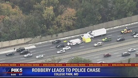 1 dead, 4 in custody after armed robbery leads to police chase and crash on Beltway