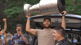 Caps players celebrate in Arlington with Stanley Cup
