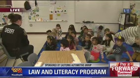 Pay It Forward: Loudoun County sheriff's deputies inspire students with reading