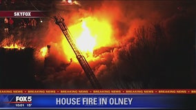 Resident, 2 firefighters injured after townhouse fire breaks out in Olney
