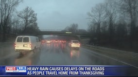Cold and wet weather hampers holiday travel, shopping