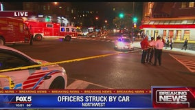 2 DC police officers, DPW employee struck by pickup truck