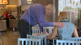 Photographer catches Chick-fil-A worker praying over customer