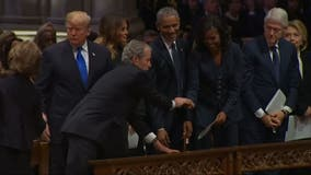 VIDEO: George W. Bush hands Michelle Obama piece of candy at funeral for George H.W. Bush