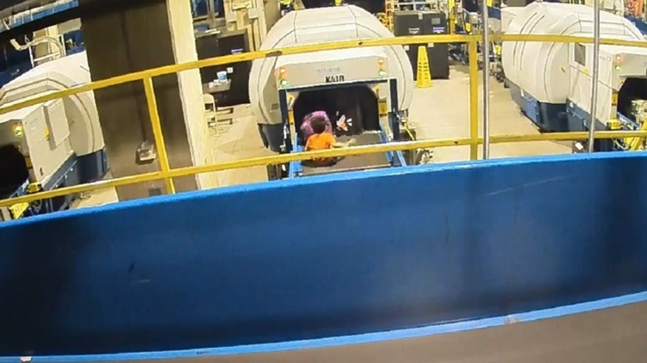 Video shows young boy riding baggage conveyor belt at