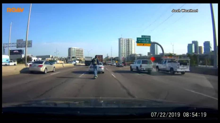 Dash camera captures Lime scooter rider on I-35 in downtown