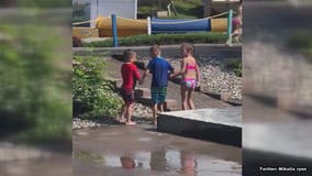 Heartwarming moment two friends help tired little boy with cerebral palsy walk at water park