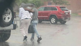 'I'm touched by this kid': Officer applauds teen for walking senior citizen to car in rain