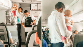 Frontier flight attendant helps calm crying baby: 'Mom looked like she could've used a well-deserved break'