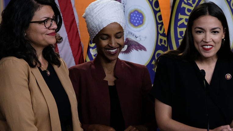 U.S. Reps. Rashida Tlaib (D-MI), Ilhan Omar (D-MN) and Alexandria Ocasio-Cortez (D-NY) listen during a news conference at the U.S. Capitol on July 15, 2019 in Washington, DC. (Photo by Alex Wroblewski/Getty Images)