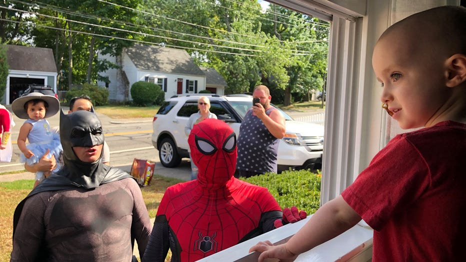 Superheroes, including Batman and Spiderman, arrive outside of Quinn Waters' window on Aug. 25, 2019. (Photo credit: The Mighty Quinn / Facebook)