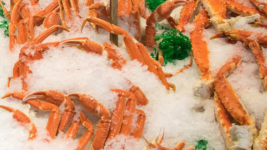 FILE - Crab legs on display at a grocery store.