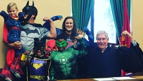 Family wears superhero costumes to 'fearless and brave' 4-year-old's adoption