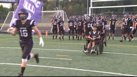 High school student with rare disorder takes football field for the first time at Potomac Falls as honorary captain