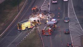 Trash truck fire spreads garbage along westbound lanes of the Dulles Access Road causing delays