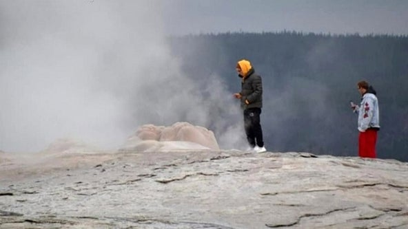 Tourists issued citations at Yellowstone National Park's Old Faithful for 'thermal trespassing'