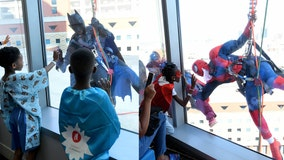 Superhero window washers bring smiles to sick kids at Children's Alabama