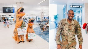 Wife, kids dress in T-Rex costumes to welcome home husband from deployment