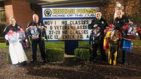 Missouri police officers pool money, buy costumes for students' Halloween party