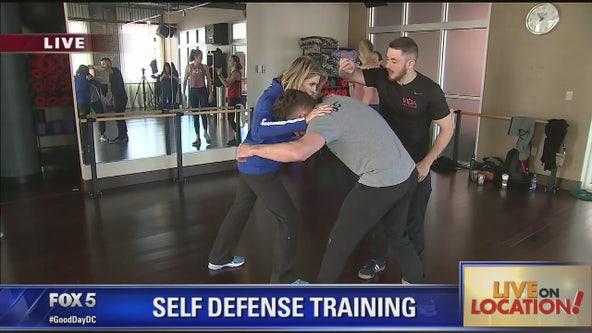 Learning self-defense skills at Vida Fitness